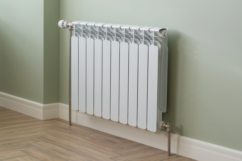 Heating Radiator, White radiator in an apartment
